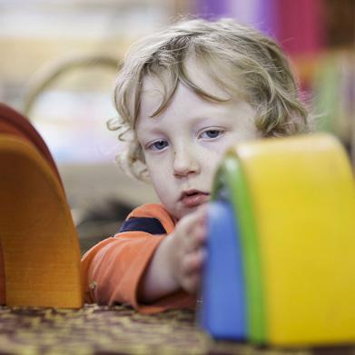 Child with Wooden Rainbow at Batman Park Kindergarten